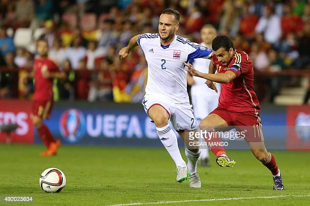Luxembourg's defender Maxime Chanot vies with Spain's forward Pedro during the Euro 2016 qualifying football match Spain vs Luxembourg at Las Gaunas...