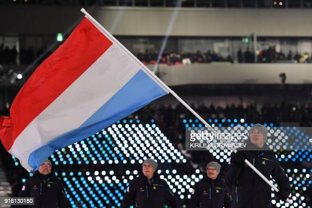 Luxembourg's delegation and flagbearer Matthieu Osch parade during the opening ceremony of the Pyeongchang 2018 Winter Olympic Games at the...