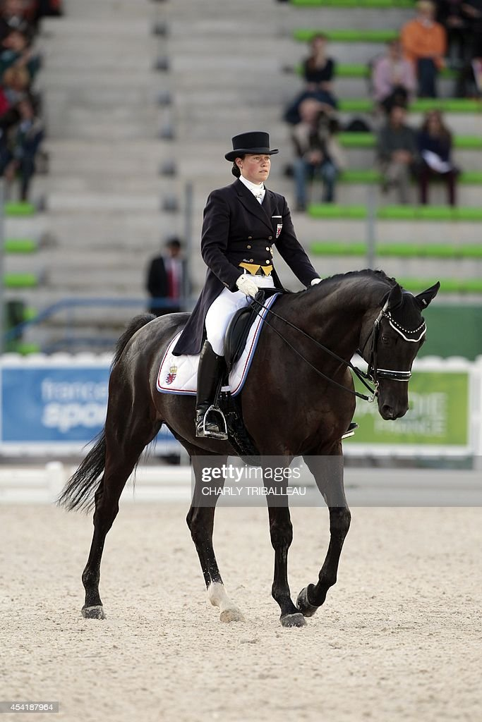 Luxembourg's Diane Erpedling rides Woltair TSF on August 26, 2014 during the second session of the Dressage Grand Prix of the 2014 FEI World Equestrian Games at D'Ornano Stadium in the northwestern French city of Caen. TRIBALLEAU