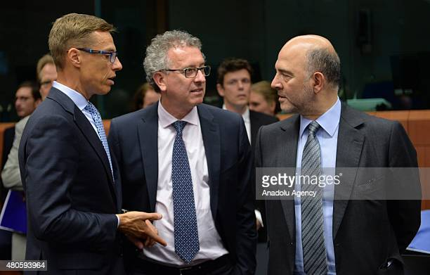 Luxembourg's Finance Minister Pierre Gramegna Finnish Finance Minister Alexander Stubb and European Commissioner for Economic and Financial Affairs...