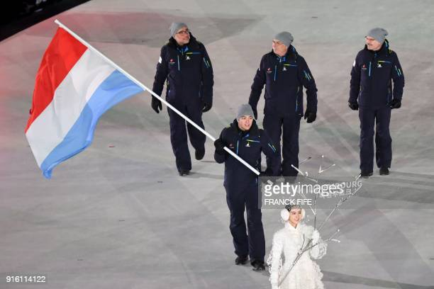 Luxembourg's flagbearer Matthieu Osch leads his delegation as they parade during the opening ceremony of the Pyeongchang 2018 Winter Olympic Games at...
