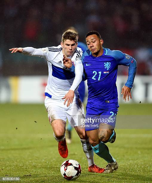 Luxembourg's Florian Bohnet vies Netherlands' Memphis Depay during the World Cup 2018 qualifying match between Luxembourg and Netherlands on November...