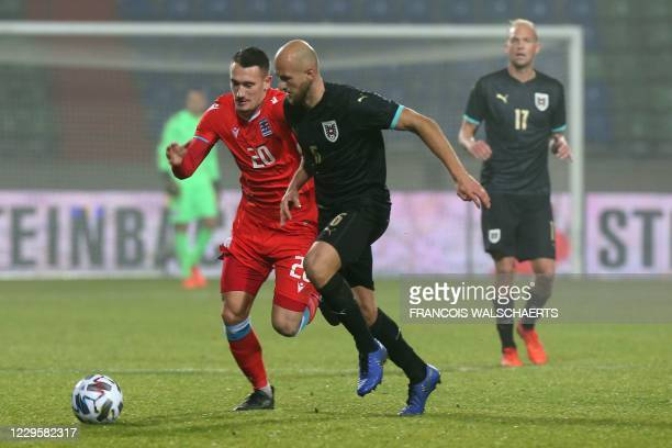 Luxembourg's forward Edvin Muratovic is challenged by Austria's midfielder Gernot Trauner during the friendly football match between Luxembourg and...