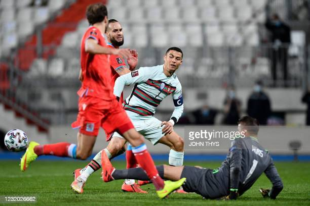 Luxembourg's goalkeeper Anthony Moris stops the ball shot by Portugal's forward Cristiano Ronaldo during the FIFA World Cup Qatar 2022 qualification...