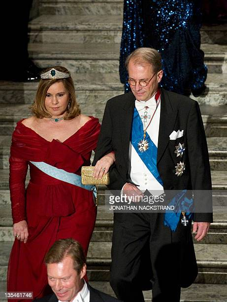 Luxembourg's Grand Duchess Maria and Per Westerberg arrive at Stockholm Town Hall to attend the Nobel banquet after the 2011 Nobel Prize award...