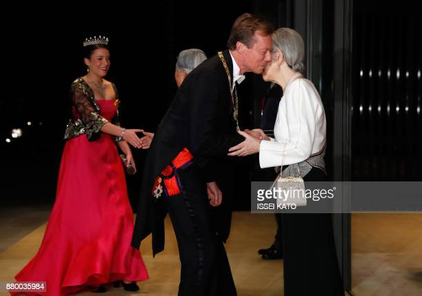 Luxembourg's Grand Duke Henri and Princess Alexandra are welcomed by Japan's Emperor Akihito and Empress Michiko upon their arrival for the state...