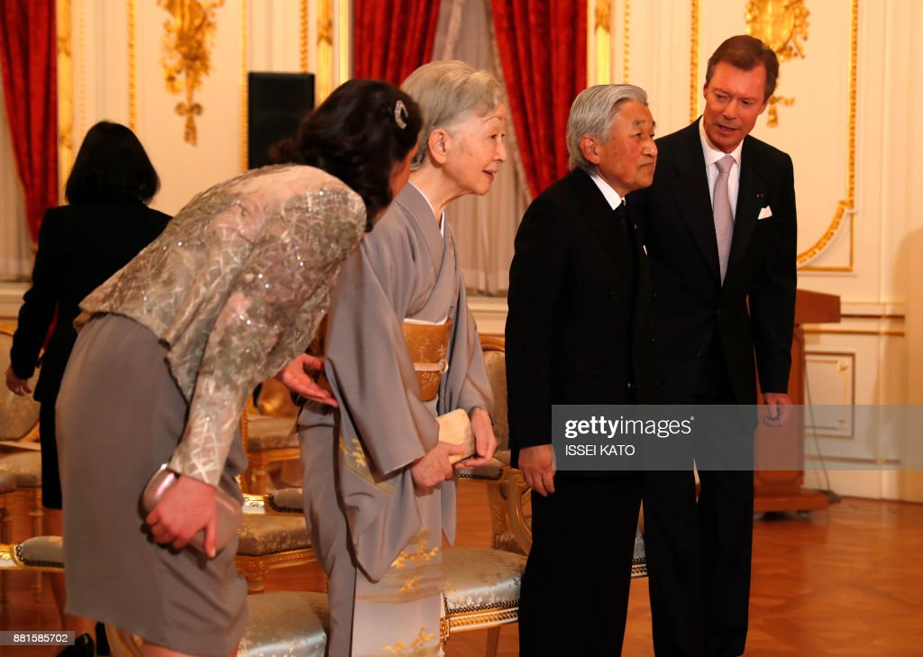 Luxembourg's Grand Duke Henri (R) and Princess Alexandra (L) greet Japan's Emperor Akihito (2nd R) and Empress Michiko during a concert hosted by the grand duke at the Akasaka Palace state guest house in Tokyo on November 29, 2017. Grand Duke Henri of Luxembourg is on a four-day visit to Japan. /