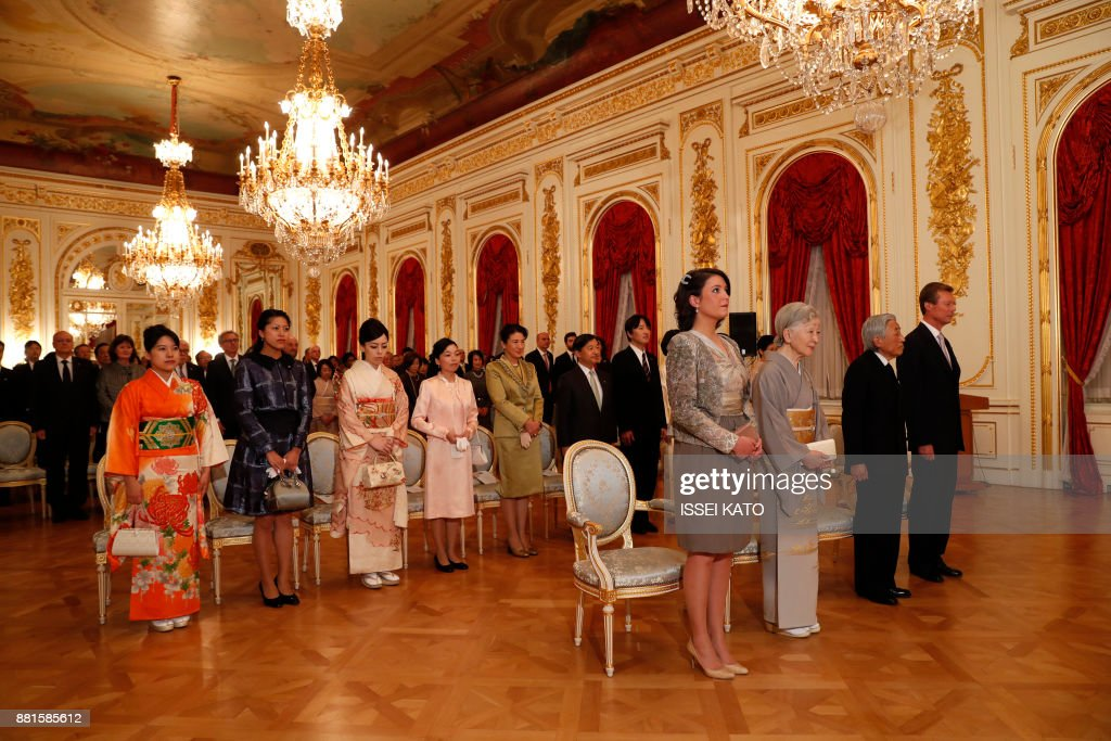 Luxembourg's Grand Duke Henri (R) and Princess Alexandra (4th R) listen to a national anthem with Japan's Emperor Akihito (2nd R) and Empress Michiko (3rd R) during a concert hosted by the grand duke at the Akasaka Palace state guest house in Tokyo on November 29, 2017. Grand Duke Henri of Luxembourg is on a four-day visit to Japan. /