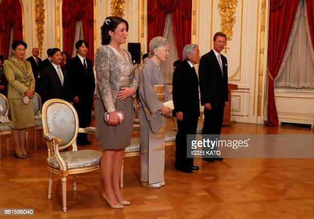 Luxembourg's Grand Duke Henri and Princess Alexandra listen to a national anthem with Japan's Emperor Akihito and Empress Michiko during a concert...