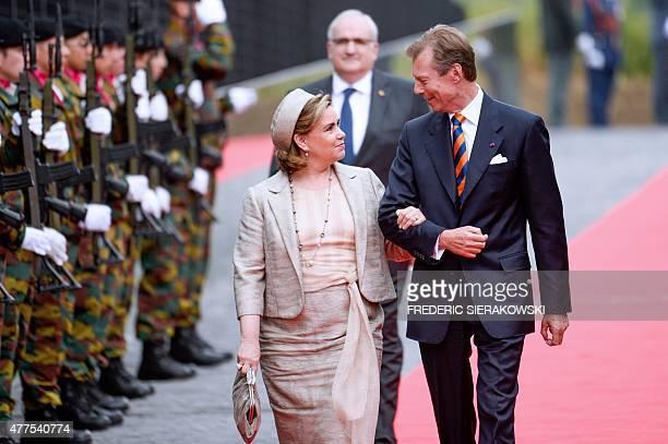 Luxembourg's Grand Duke Henri, Grand Duchess Maria Teresa walk to a ceremony marking the 200th anniversary of the Battle of Waterloo on June 18, 2015...