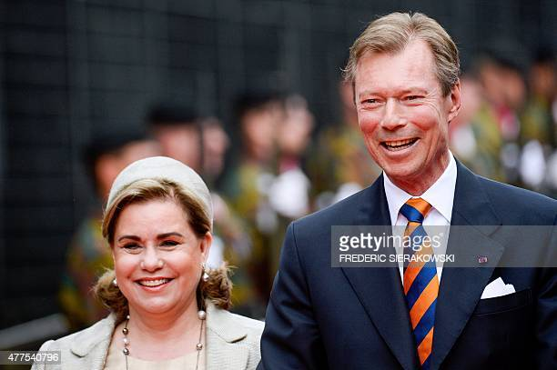Luxembourg's Grand Duke Henri Grand Duchess Maria Teresa walk to a ceremony marking the 200th anniversary of the Battle of Waterloo on June 18 2015...