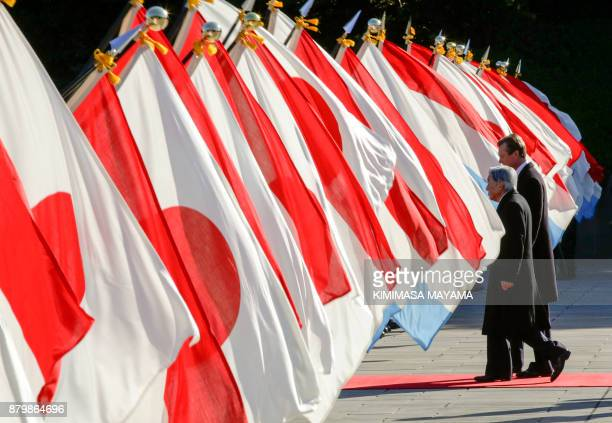 Luxembourg's Grand Duke Henri is escorted by Japan's Emperor Akihito for the welcoming ceremony upon his arrival at the Imperial Palace in Tokyo on...