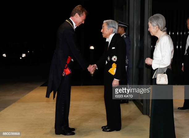 Luxembourg's Grand Duke Henri is welcomed by Japan's Emperor Akihito and Empress Michiko upon his arrival for the state banquet at the Imperial...