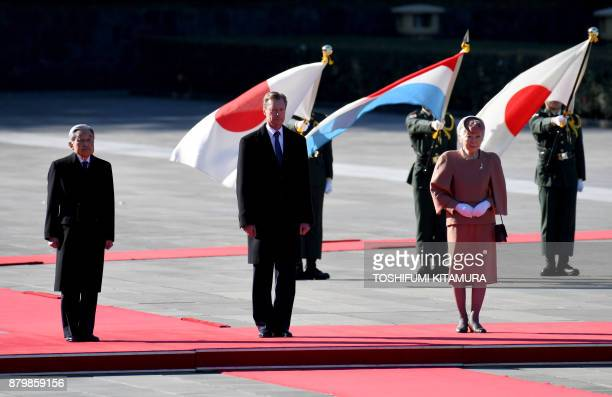 Luxembourg's Grand Duke Henri listens to the national anthems with Japanese Emperor Akihito and Empress Michiko during his welcoming ceremony at the...