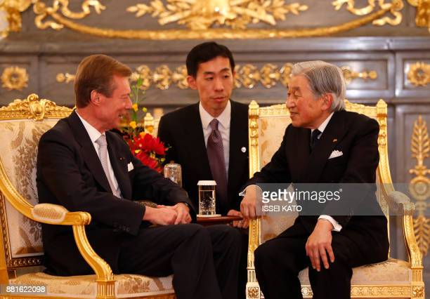Luxembourg's Grand Duke Henri talks with Japan's Emperor Akihito during a farewell call made by the Emperor and Empress Michiko at Akasaka Palace...