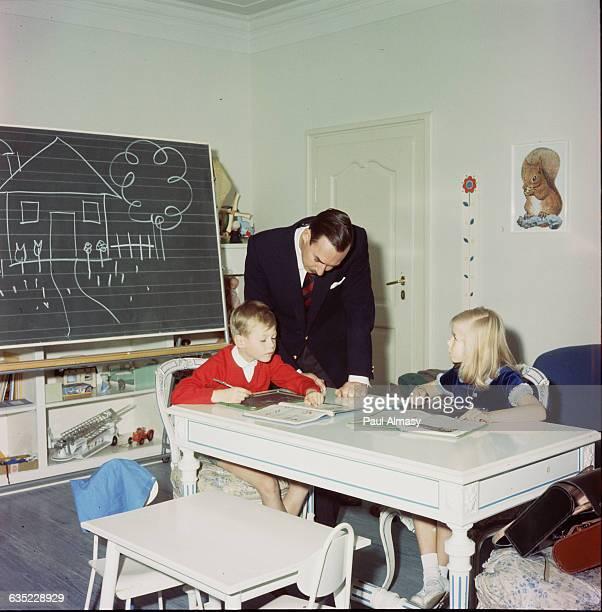 Luxembourg's Grand Duke Jean looks over his children's schoolwork 1966 Princess Marie Astrid is the Duke's eldest child Prince Henri the eldest son...