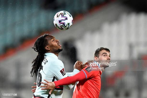 Luxembourg's midfielder Danel Sinani eyes the ball as he fights for it with Portugal's midfielder Renato Sanches during the FIFA World Cup Qatar 2022...