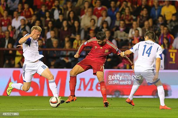 Luxembourg's midfielder Laurent Jans and Luxembourg's defender Kevin Malget vie with Spain's forward Alvaro Morata during the Euro 2016 qualifying...
