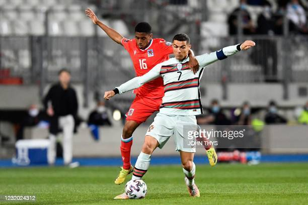 Luxembourg's midfielder Leandro Barreiro fights for the ball with Portugal's forward Cristiano Ronaldo during the FIFA World Cup Qatar 2022...