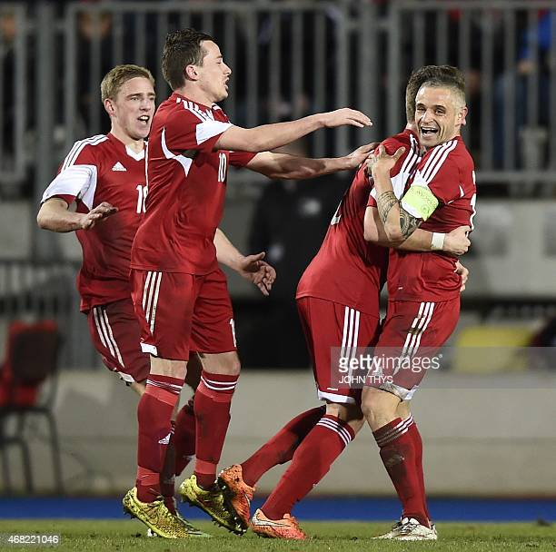Luxembourg's midfielder Mario Mutsch celebrates with teammates after scoring during the friendly football match between Luxembourg and Turkey at the...