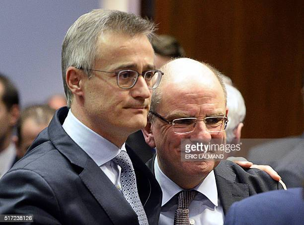 Luxembourg's Minister of Justice Felix Braz embraces Belgium's Minister of Justice Koen Geens during an 'Extraordinary meeting of ministers for...