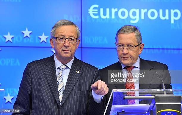 Luxembourg's Prime Minister and Eurogroup president JeanClaude Juncker and European Financial Stability Facility Chief Executive Klaus Regling give a...