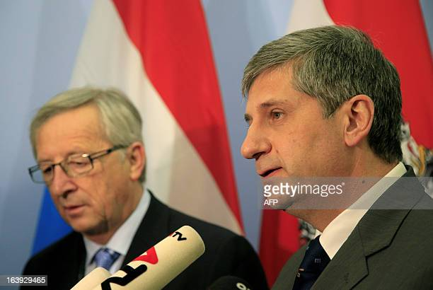 Luxembourg's Prime Minister Jean Claude Juncker and the Austrian Foreign Minister Michael Spindelegger give a joint press conference during their...