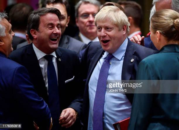 Luxembourg's Prime minister Xavier Bettel and Britain's Prime Minister Boris Johnson share a laugh during an European Union Summit at European Union...