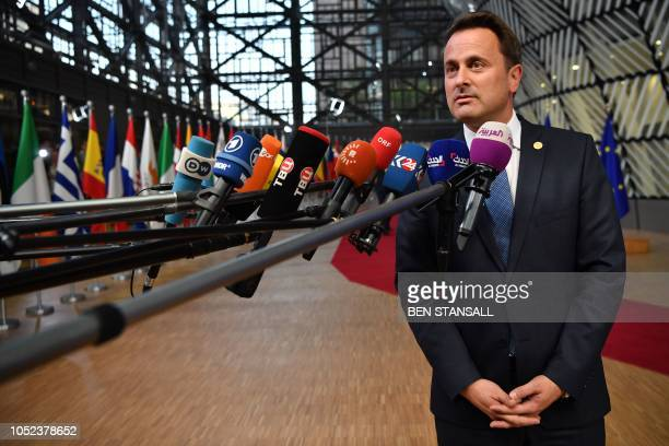 Luxembourg's Prime Minister Xavier Bettel answers to journalists his arrival at the European Council in Brussels on October 17 2018 British Prime...