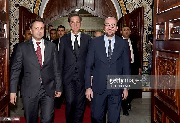 Luxembourg's Prime Minister Xavier Bettel Dutch Prime Minister Mark Rutte and Belgian Prime Minister Charles Michel arrive for a meeting with...