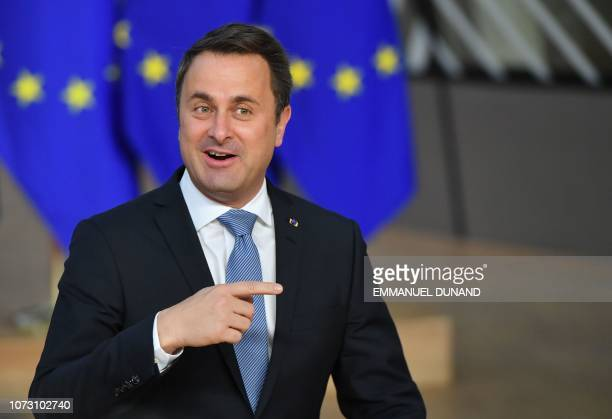 Luxembourg's Prime Minister Xavier Bettel gestures as he arrives on December 14 2018 in Brussels during the second day of a European Summit aimed at...