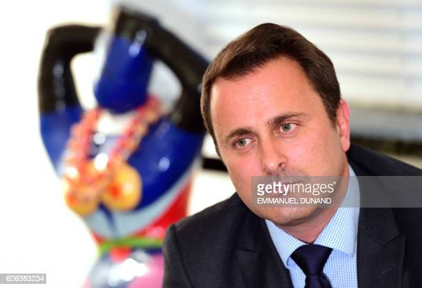 Luxembourg's Prime Minister Xavier Bettel looks on during an interview with AFP at his office in Luxembourg on November 28 2016 Bettel said Britain...