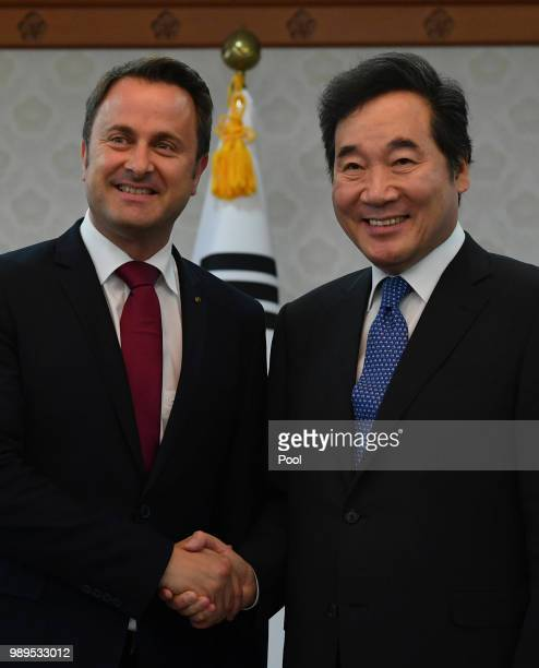 Luxembourg's Prime Minister Xavier Bettel shakes hands with South Korean Prime Minister Lee Nakyeon during their meeting on July 2 2018 in Seoul...