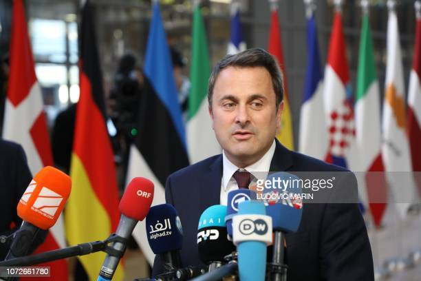 Luxembourg's Prime minister Xavier Bettel speaks to medias as he arrives on December 13 2018 in Brussels for a European Summit aimed at discussing...