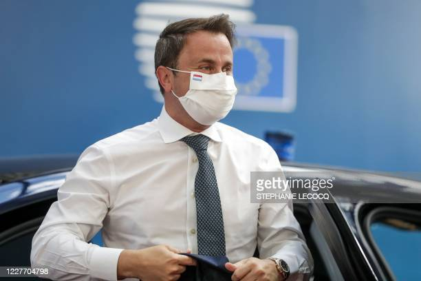 Luxembourg's Prime Minister Xavier Bettel wearing a protective face mask arrives for the fourth day of an EU summit at the European Council building...
