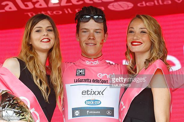 Luxembourg's rider Bob Jungels of team Etixx Quick Step celebrates the pink jersey of the overall leader on the podium of the 11th stage of the 99th...