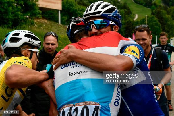 TOPSHOT Luxemburg's Bob Jungels embraces his Belgium's Quick Step Floors cycling team teammate France's Julian Alaphilippe as Poland's Michal...