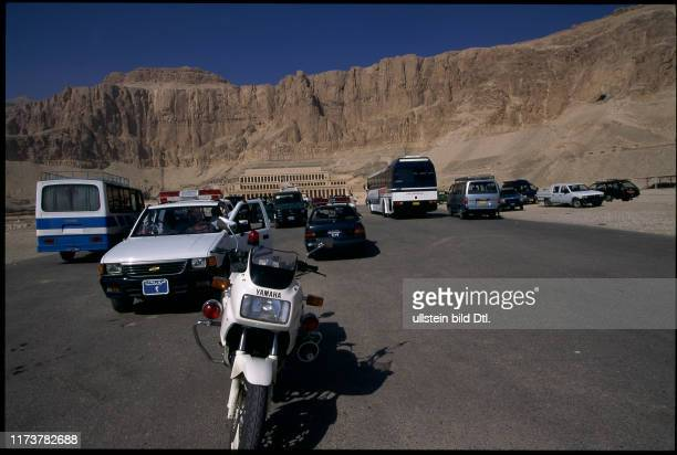 Police Vehicles in front of the Temple