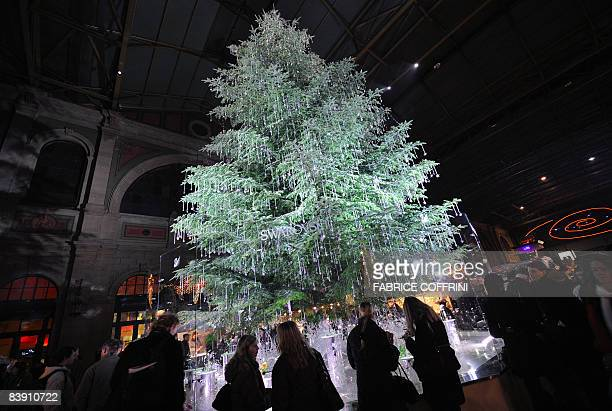 LEHMANN A luxurious adorned Christmas tree is admired by passerby on December 2 2008 at the main railway station in Zurich For the moment wealthy...