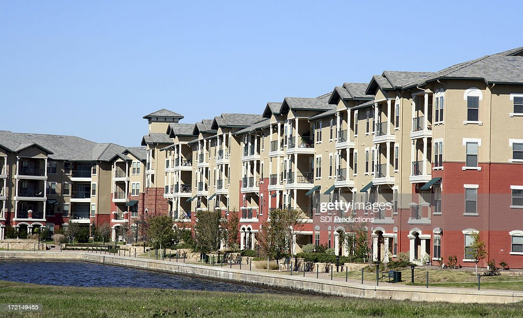 Luxurious Apartment Complex Overlooking A Pond : Stock Photo