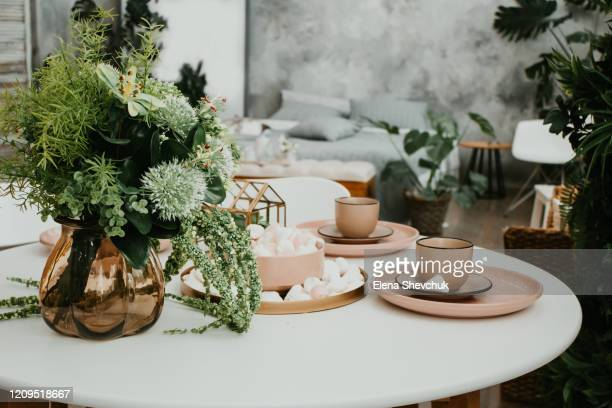 luxurious bedroom interior with a tray with a cup, saucer, marshmallows and flowers on the table. - elena blume stock-fotos und bilder