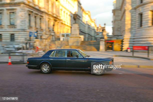 """luxurious bentley turbo r driving by on parliament street in westminster in central london - """"sjoerd van der wal"""" or """"sjo"""" stock pictures, royalty-free photos & images"""