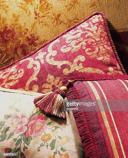 Luxurious cushions pilled in bright room.