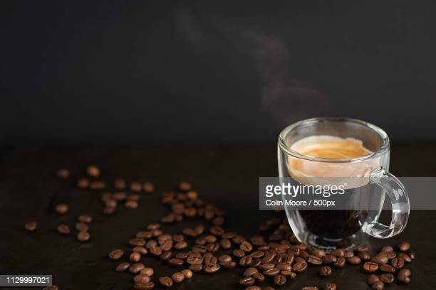 luxurious espresso on black - espresso stock pictures, royalty-free photos & images