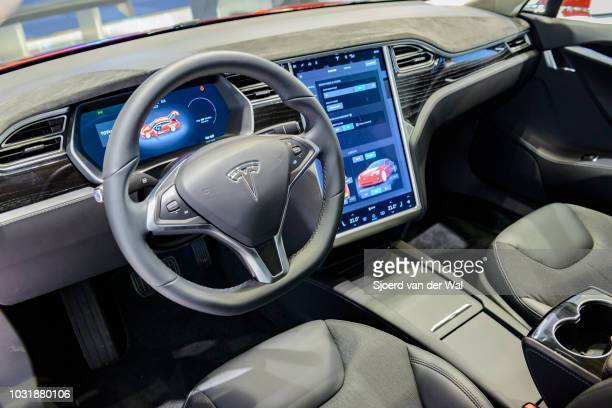 Luxurious interior on a Tesla Model S full electric luxury car with a large touch screen and dashboard screen The car is fitted with leather seats...