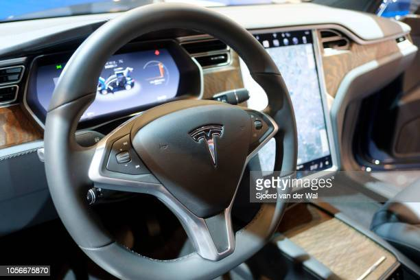 Luxurious interior on a Tesla Model X full electric luxury crossover SUV car with a large touch screen and dashboard screen on display at Brussels...