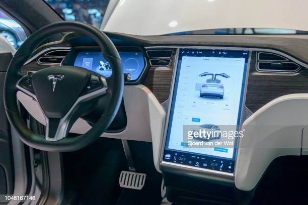 Luxurious interior on a Tesla Model X P90D full electric luxury crossover SUV car with a large touch screen and dashboard screen on display at...