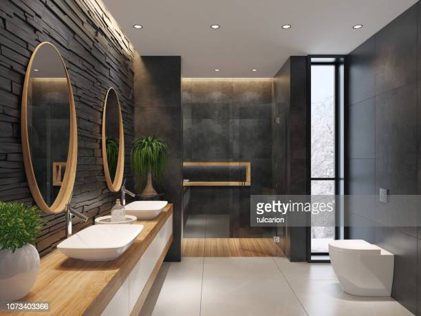 luxurious minimalist bathroom with slate black stone wall - moderno foto e immagini stock