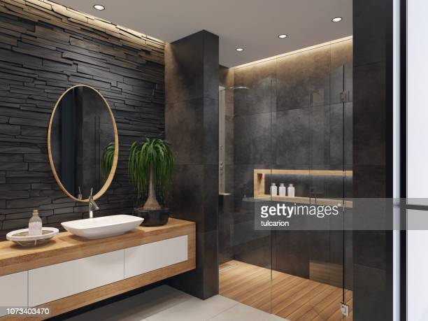 luxurious minimalist bathroom with slate black stone wall - bathroom stock photos and pictures
