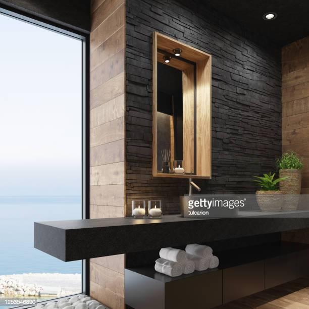 salle de bains moderne luxueuse de spa de maison avec le mur empilé noir mat et le miroir rustique en bois - massage room photos et images de collection